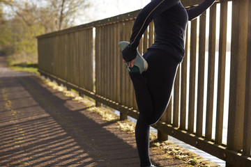 Woman Stretching During Early Morning Outdoor Run