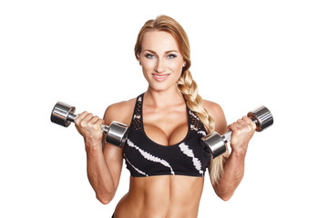 Sexy blonde woman holding dumbbells isolated