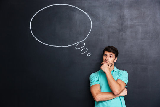 Pensive attractive young man with thinking bubble