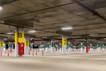 Underground car park without cars, with sections labeled