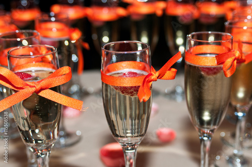 Sparkling Wine With Raspberry Ribbon Decorated Champagne
