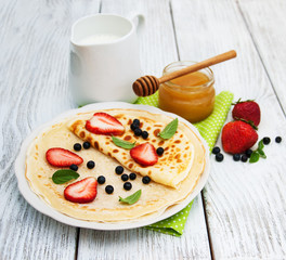 crepes with strawberries and blueberries