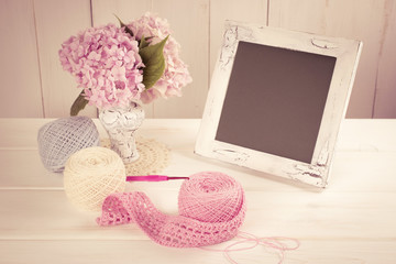Yarn for crochet and hortensia in vase with photo frame