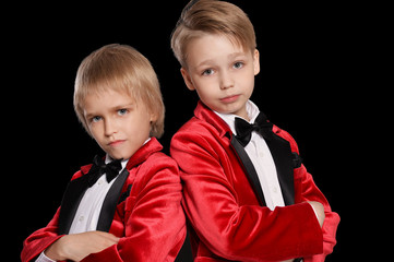 Handsome   little boys in a tuxedo