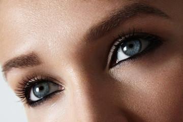 women's blue eyes closeup photo