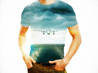 Fotomurales - Man and flying plane in sky