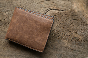 Leather wallet on wood texture