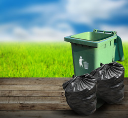 Garbage bins ecology concept with nature background.