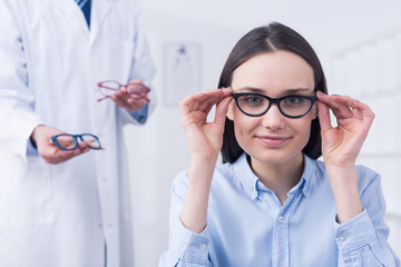 Woman choosing the perfect glasses