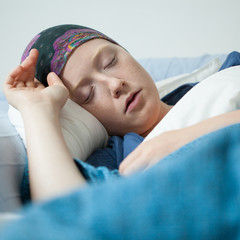 Young woman having tumor sleeping