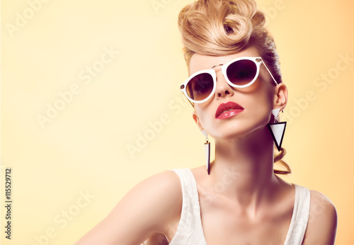 Wall mural Fashion portrait Hipster Model woman, Stylish hairstyle. Fashion Makeup. Blond sexy Model, Trendy Glamour fashion Sunglasses. Playful cheeky fashion girl. Unusual Creative.Party disco mohawk hairstyle