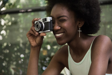 Black Woman Using a Retro Camera
