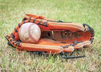 Nostalgic baseball in glove on a baseball field