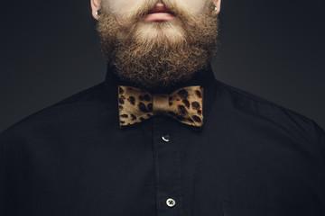 Cropped portrait of bearded male.