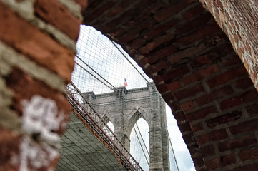 Brooklyn bridge tower and brick wall