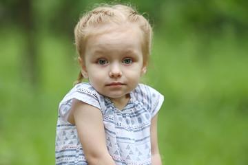 Portrait of pretty little girl shruging shoulders