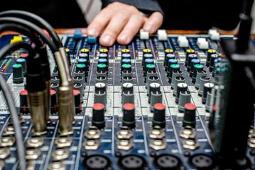 DJ audio mixer operates with one hand