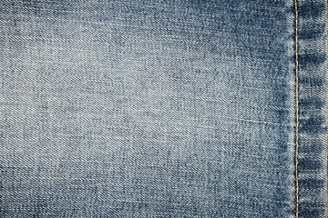 Texture of blue jeans with seam, background