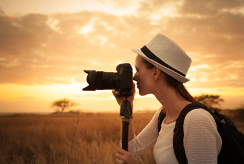 Female photographer taking pictures in a beautiful nature setting.