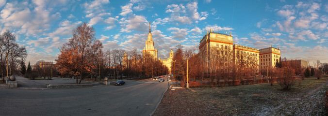 Cityscape of sunset Moscow State University under cloudy blue sky