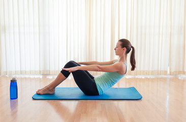 Abs workout. Woman doing sit up in the gym.