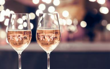 Wine glasses on a bar.