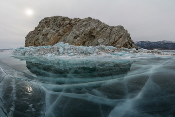 The Stone Island is surrounded by ice. Baikal, Russia.