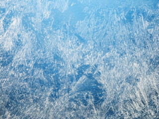 Ice crystals on the surface of the window.