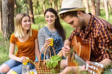 Cheerful friends enjoying nature and music