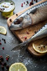 Raw mackerel on a dark background.