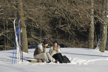 Sweden, Uppland, Lidingo, Two women relaxing during cross country skiing