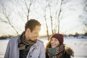 Sweden, Vasterbotten, Umea, Portrait of young couple in winter