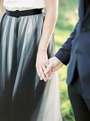 Sweden, Bride and groom holding hands