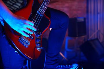 Man playing electric guitar.