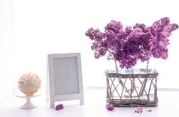 Lilac bouquets in glass jars on windowsill