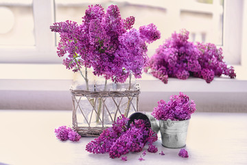 Lilac bouquet on white table