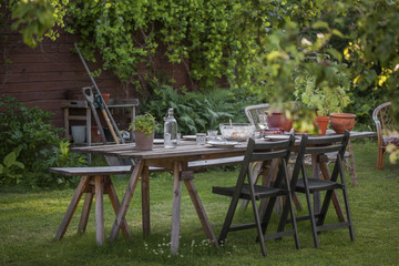 Sweden, Dining table in garden