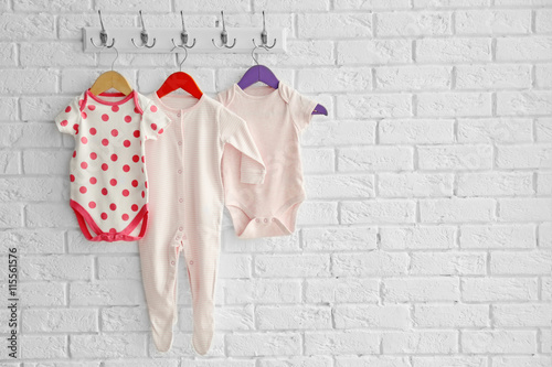 21382a5ff94b Set of baby romper on brick wall