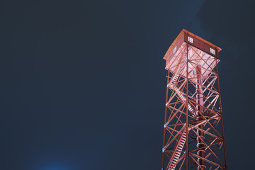 Finland, Pirkanmaa, Illuminated lookout tower against night sky