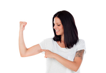 Cool brunette woman pointing her biceps
