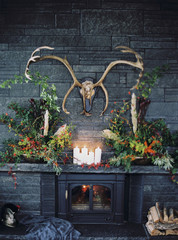 Sweden, Antlers hanging over luxurious fireplace