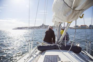Sweden, Vastkusten, Bohuslan, Marstrand, Senior men sailing in bay