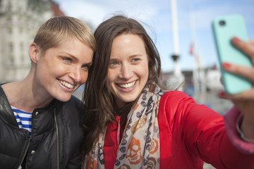 Sweden, Stockholm, Ostermalm, Two women taking selfie