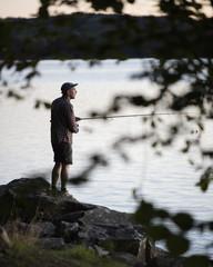Sweden, Skane, Immeln, Mid adult man fishing