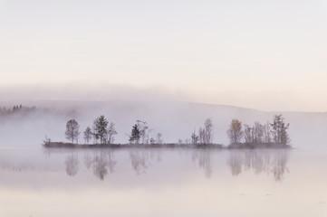 Sweden, Vastmanland, Bergslagen, Hallefors, Grythyttan, Bovik, Island on lake covered in fog
