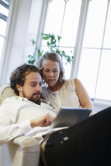 Sweden, Mid-adult couple using digital tablet