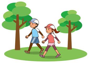 公園でウォーキングをする男性と女性