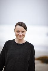 USA, California, Los Angeles, Santa Monica, Portrait of woman on beach