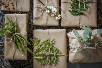 Overhead view of wrapped Christmas presents with plants