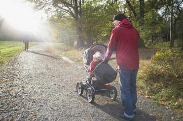 Sweden, Sodermanland, Nacka, man with son (12-17 months) walking in park
